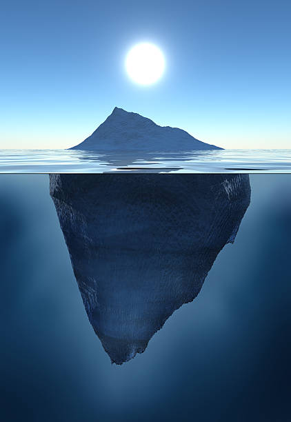 emerged and submerged parts of an iceberg - iceberg stock photos and pictures