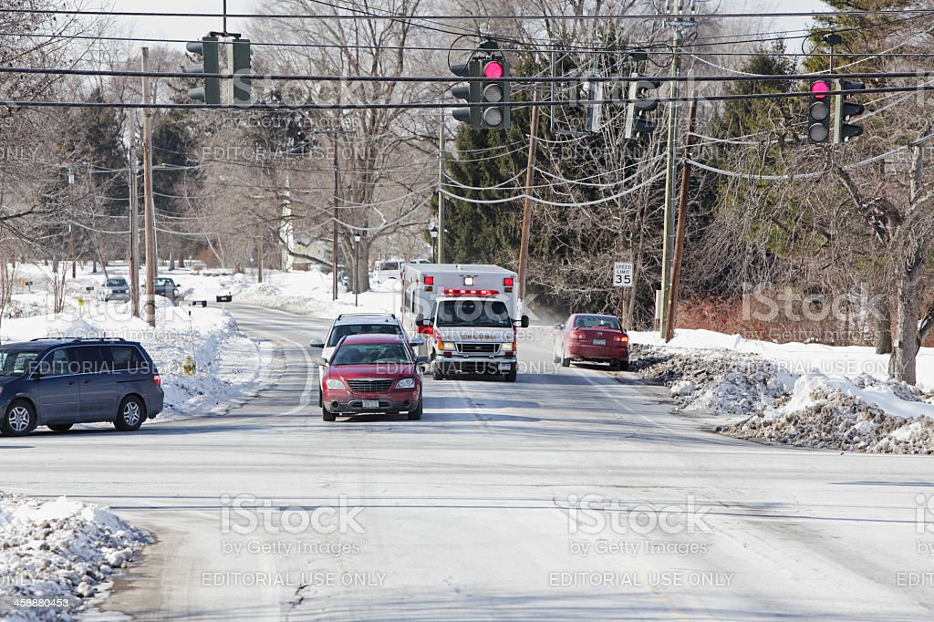 Emergency Ambulance At Busy Red Light Intersection stock photo
