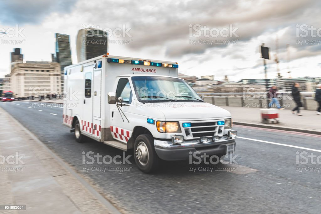 Emergency ambulance rushing on the street with emergency lights...