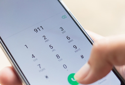 istock Emergency and urgency, dialing 911 on smartphone screen. Shallow depth of field. 1031214170