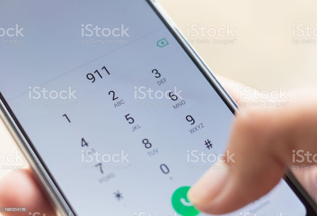 Emergency and urgency, dialing 911 on smartphone screen. Shallow depth of field. stock photo