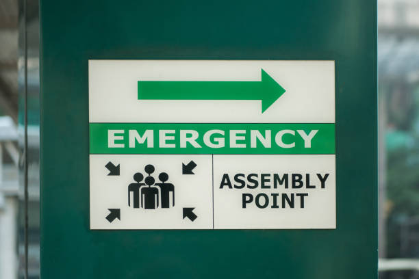Emergency assembly point sign on the column of the building. stock photo