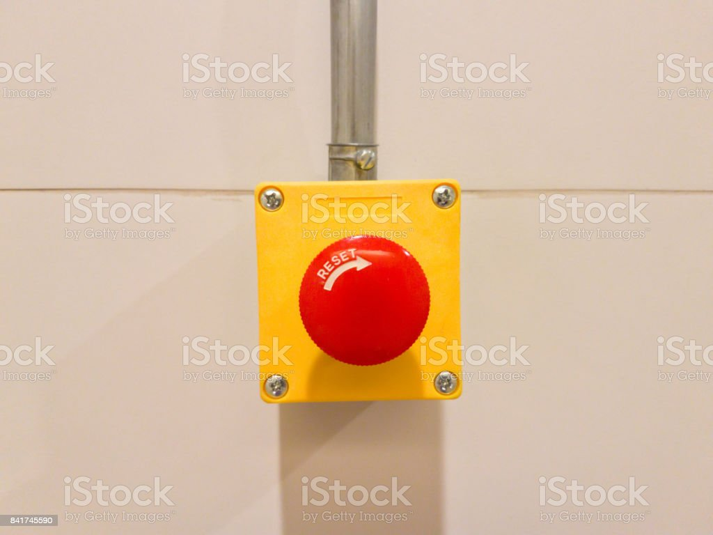 emergency botton on the wall stock photo