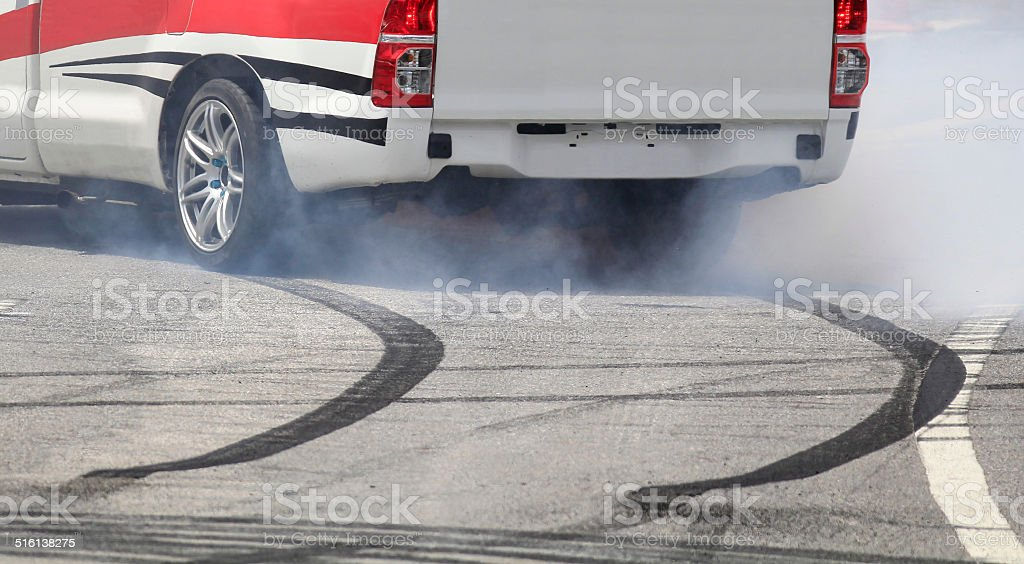 Emergency braking wheel with smoke on the highway. stock photo