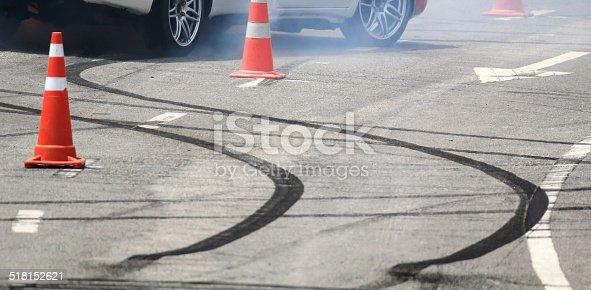 istock Emergency braking wheel with smoke on the road. 518152621