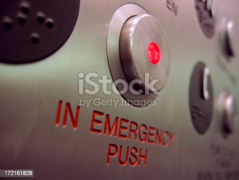 A close up shot of an emergency stop button on an elevator