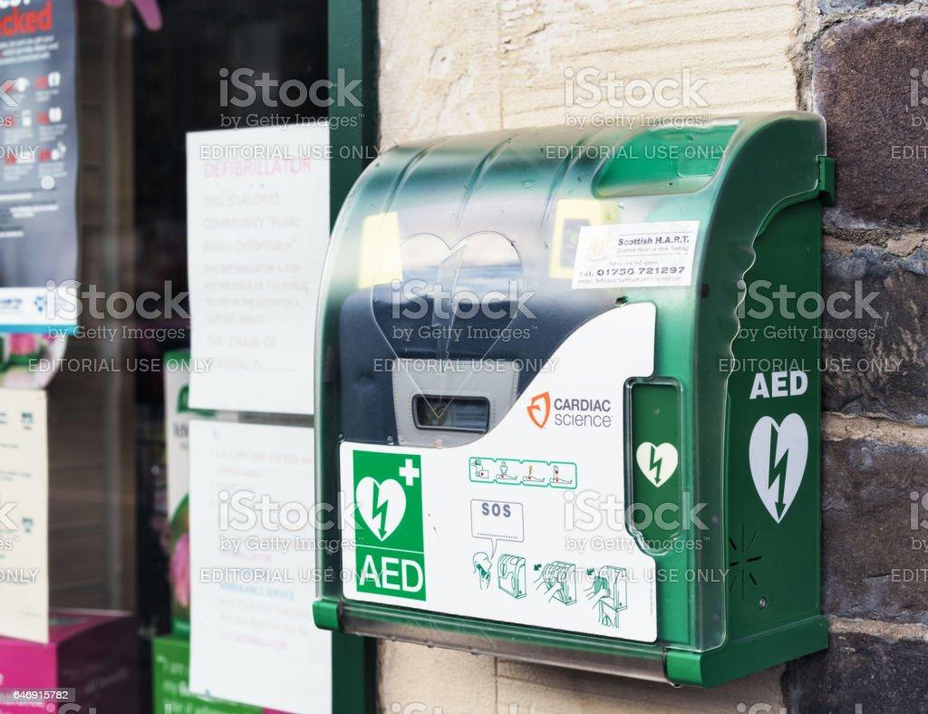 Emergency defibrillator on UK street stock photo