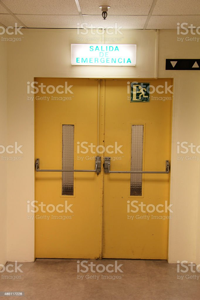 emergency door (spanish) stock photo