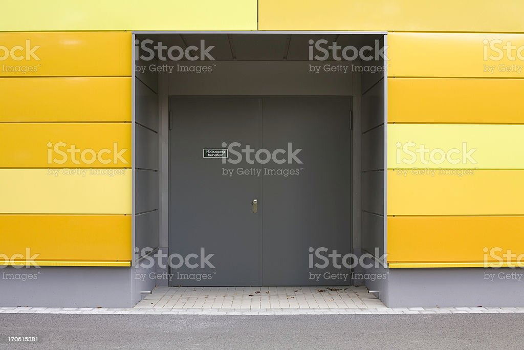 emergency exit and modern wall with yellow panels stock photo