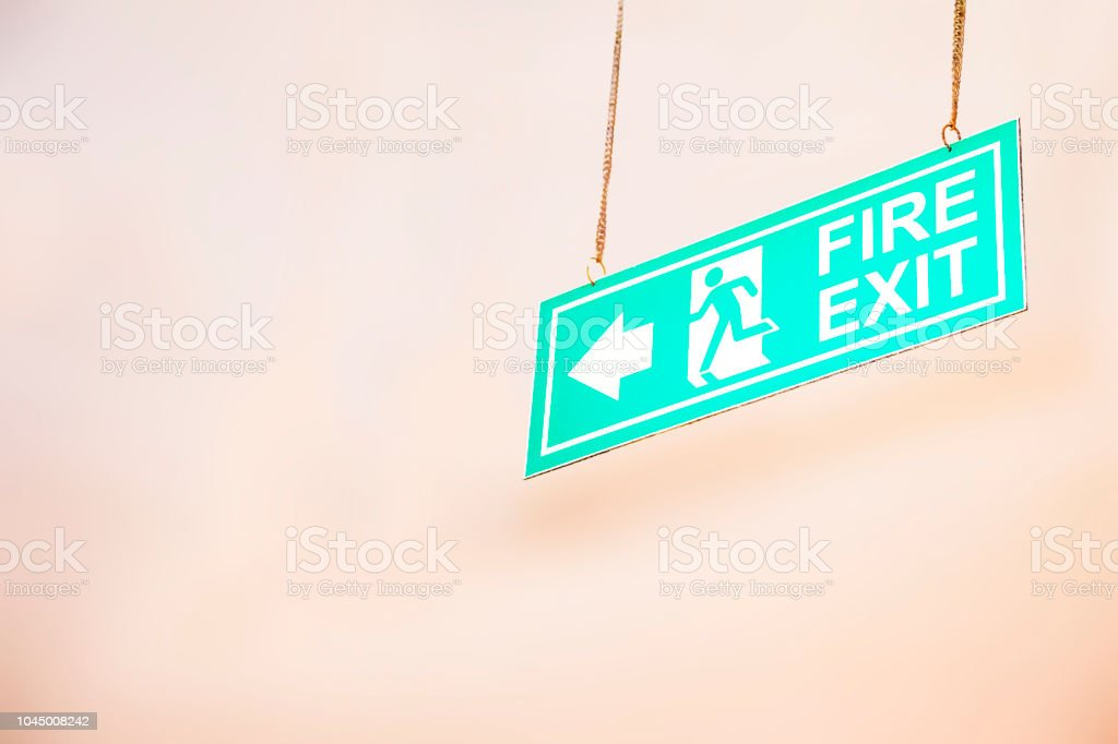 Emergency exit, fire alarm, Fire exit sign and in the blurred...