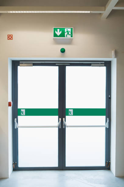 emergency exit in the store - exit sign stock photos and pictures