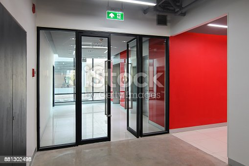 istock Emergency exit of the building with fire exit sign 881302498