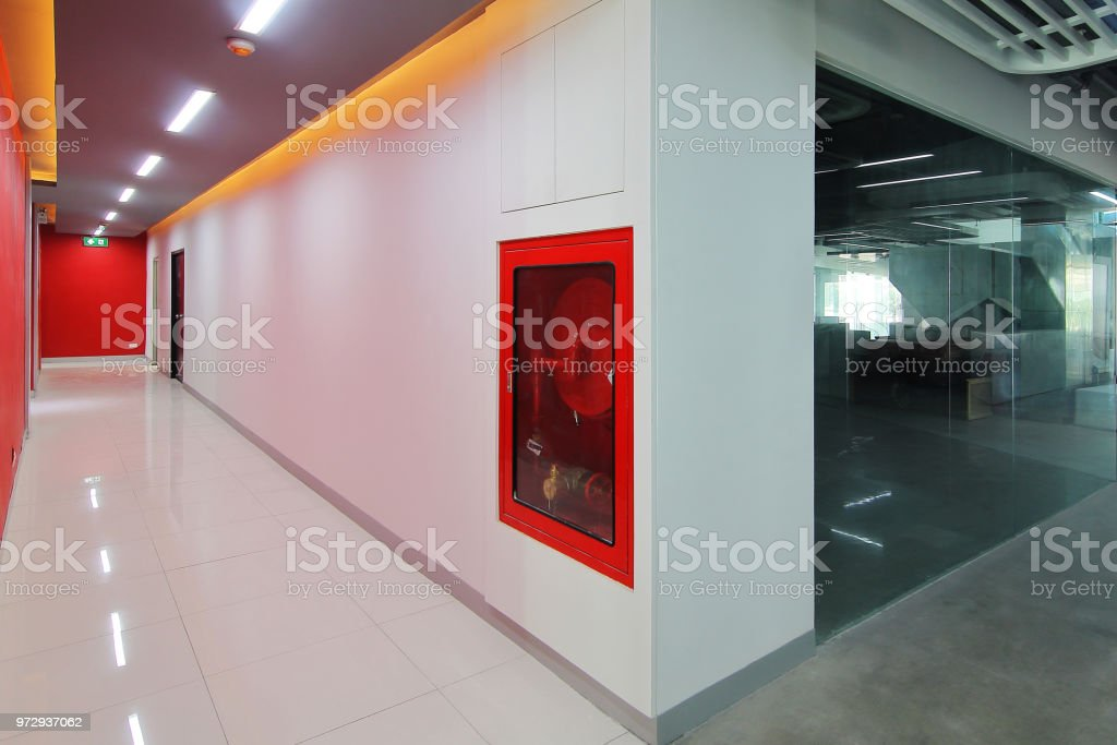 Emergency exit of the building with fire exit sign,fire alarm and...