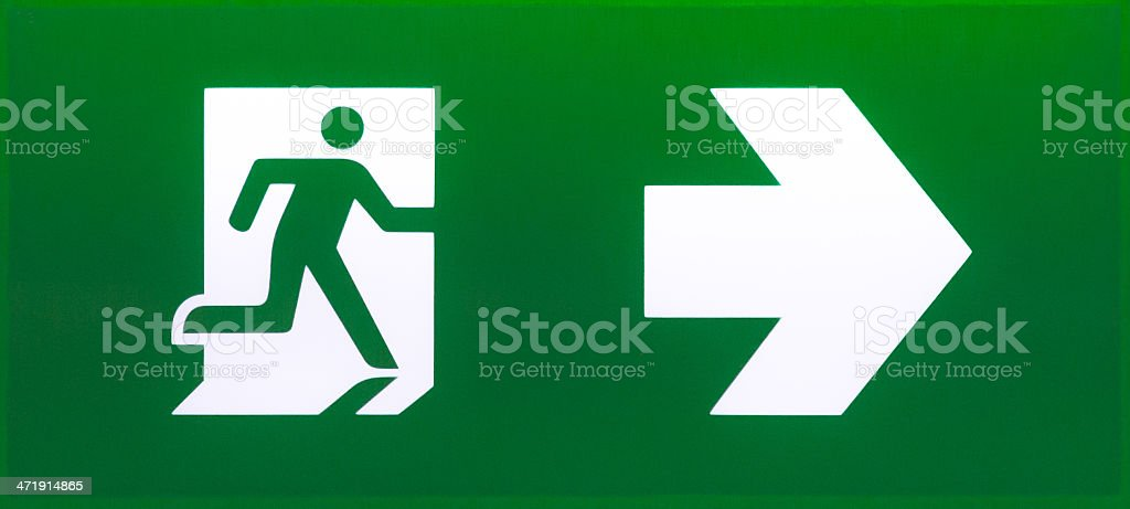 Emergency exit sign in dark green stock photo