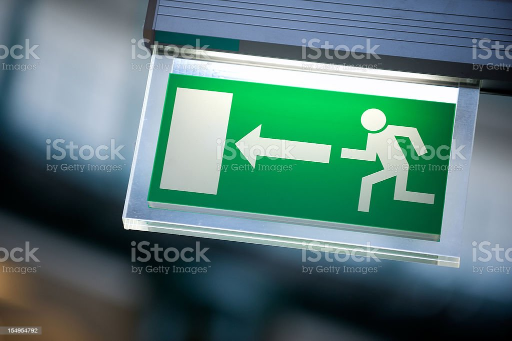 Emergency exit sign in white and green stock photo