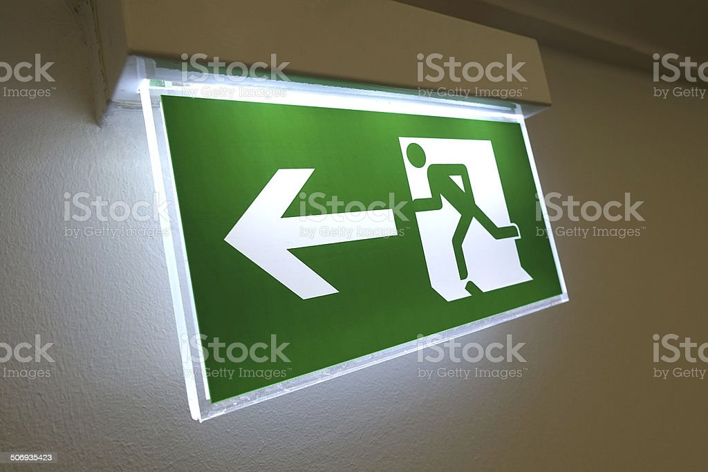 Emergency exit sign lighting at night stock photo