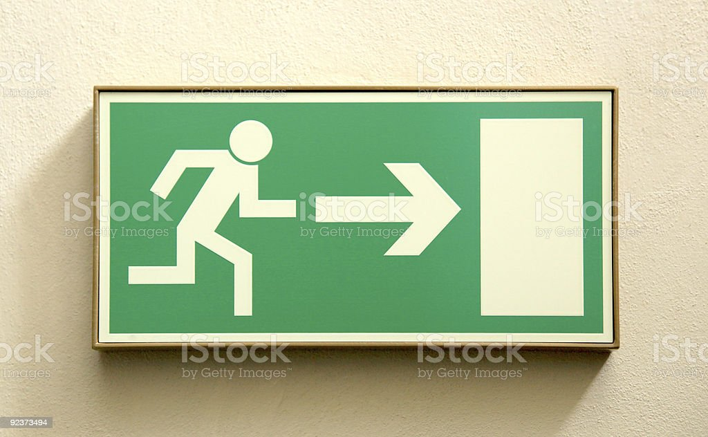 Emergency exit sign of man running towards a door stock photo