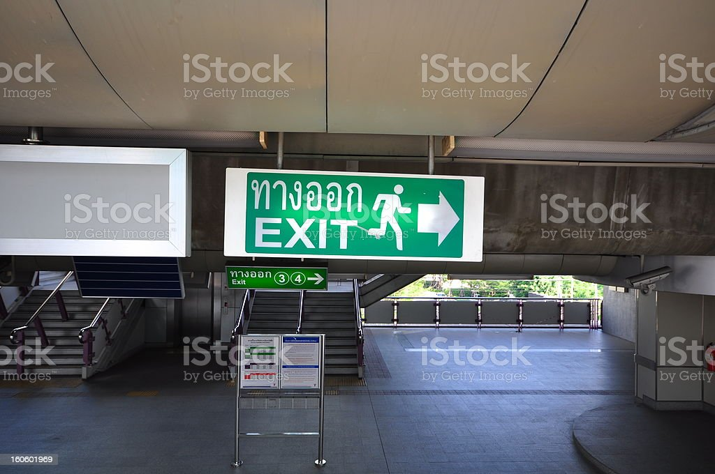 Emergency exit sign with BTS station royalty-free stock photo