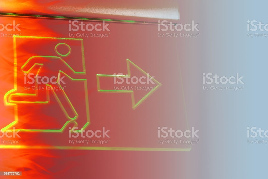 emergency exit sign with hot fire color tone effect. stock photo