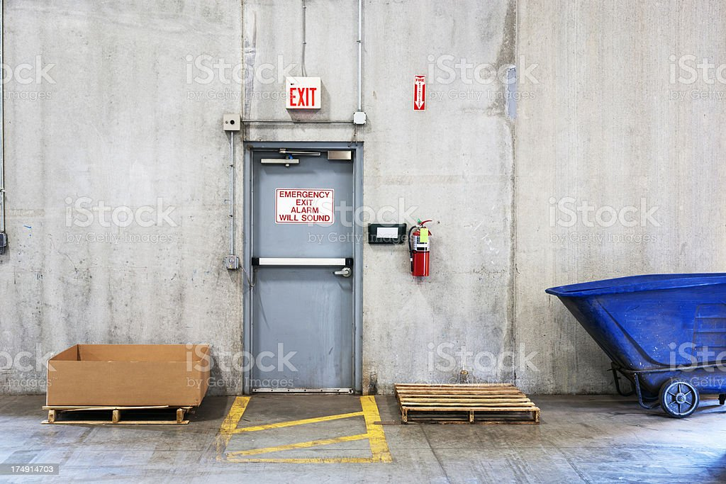 Emergency fire exit in an industrial building stock photo