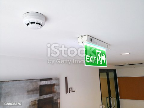 1182906669istockphoto Emergency fire exit sign show the way to escape. 1038636770
