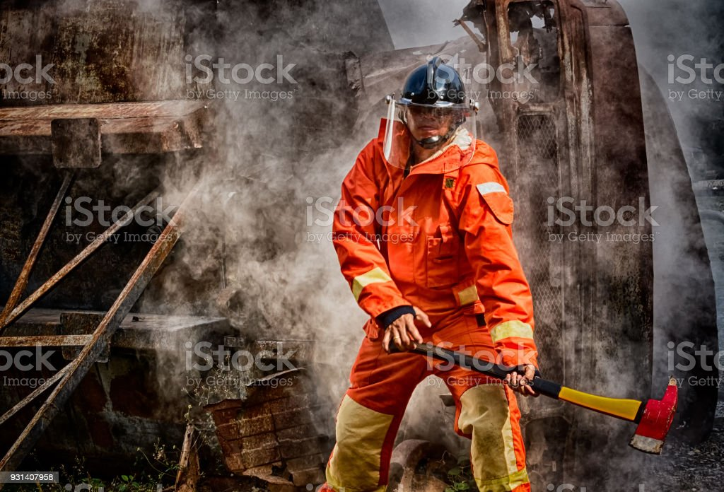 Emergency Fire Rescue training, firefighters in uniform, arm with a fire axe stock photo