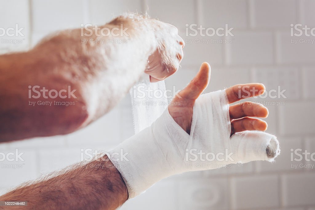 Emergency first aid - bandage on hand with plaster and bandage