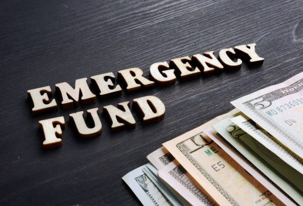 Emergency fund from wooden letters and money. Emergency fund from wooden letters and money. emergency sign stock pictures, royalty-free photos & images