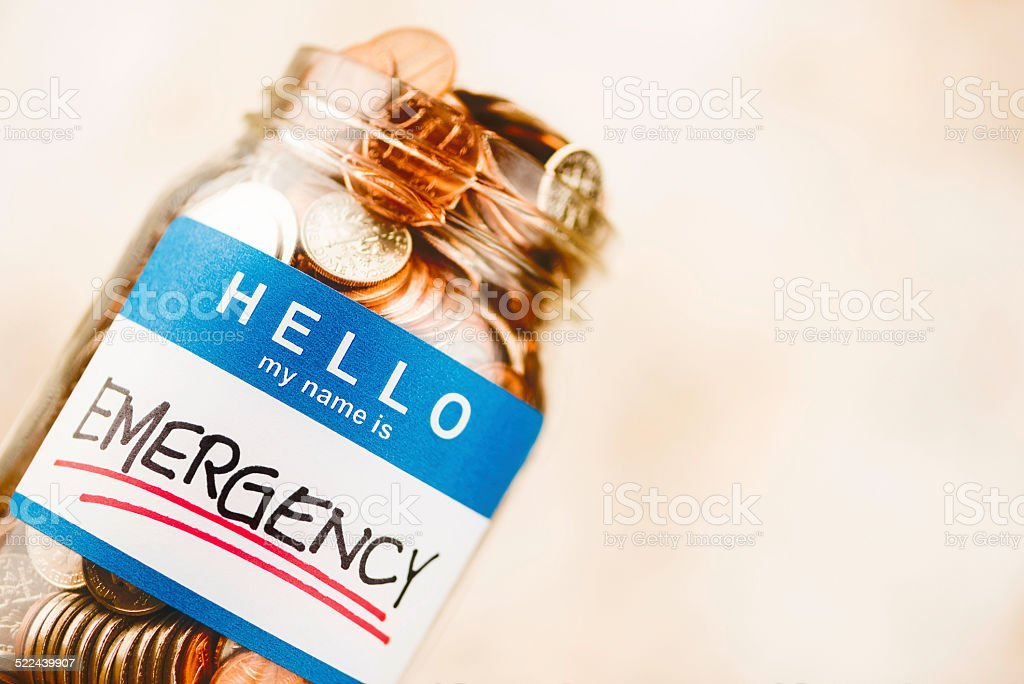 Emergency fund money jar filled with American currency stock photo