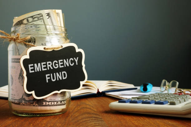 Emergency fund savings written on the jar with money. Emergency fund savings written on the jar with money. accidents and disasters stock pictures, royalty-free photos & images