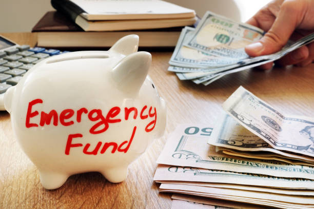 Emergency fund written on a piggy bank. Emergency fund written on a piggy bank. emergency sign stock pictures, royalty-free photos & images