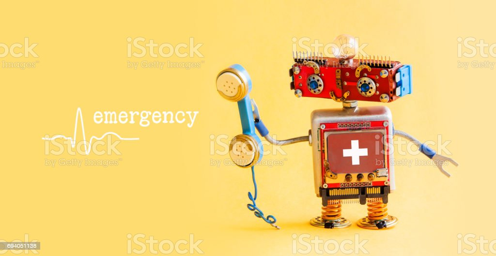 Emergency helpline medical service call center concept. Friendly robot doctor with retro styled phone. First aid advertisement template poster. Friendly toy character on yellow background stock photo