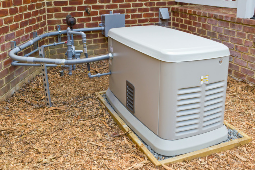 A home generator that provides electricity during a power outage.  It is connected to a propane gas supply.
