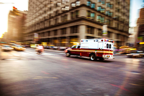 emergency in downtown - ambulance stock photos and pictures