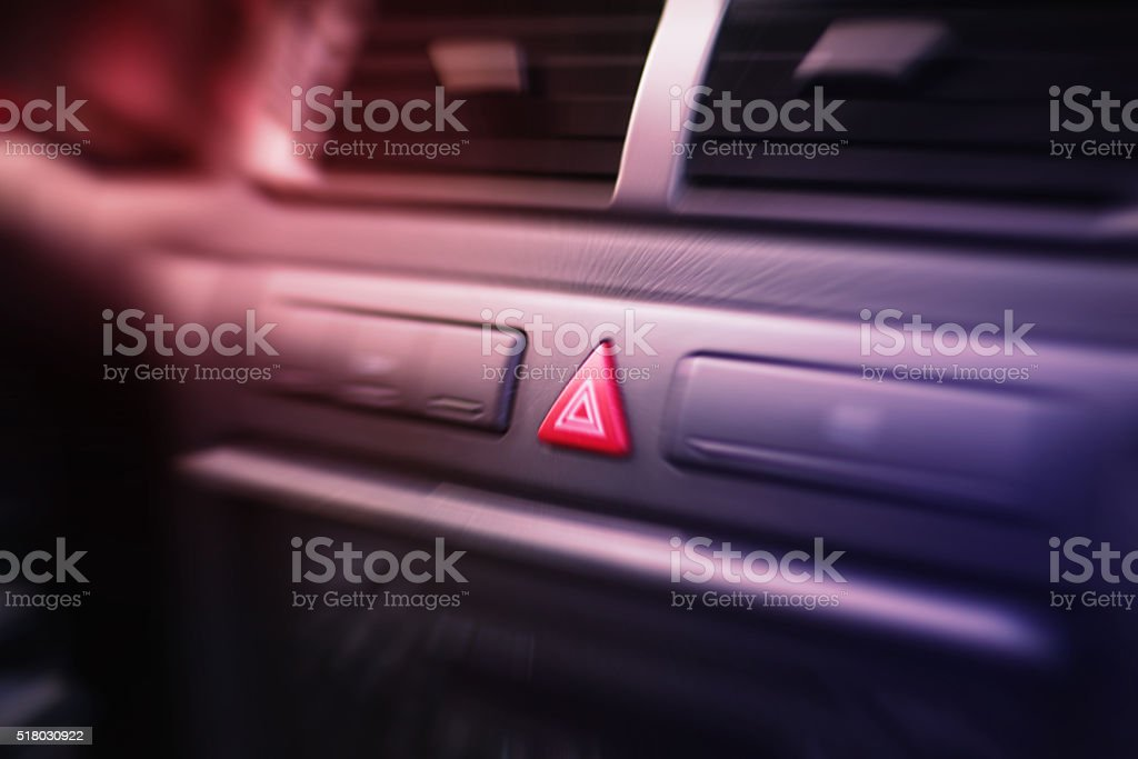 Emergency lights button inside a car. stock photo