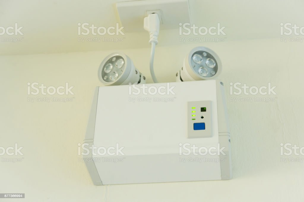 emergency lights with two lamps on the wall stock photo