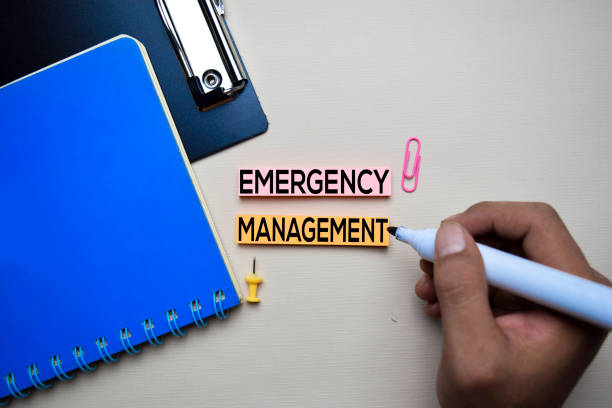 emergency management text on sticky notes with office desk concept - emergency response stock pictures, royalty-free photos & images