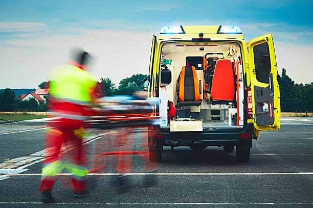 Emergency medical service Emergency medical service. Paramedic is pulling stretcher with patient to the ambulance car. ambulance staff stock pictures, royalty-free photos & images