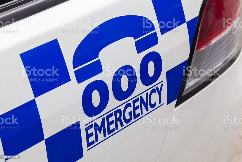 Emergency number 000 on a police car stock photo