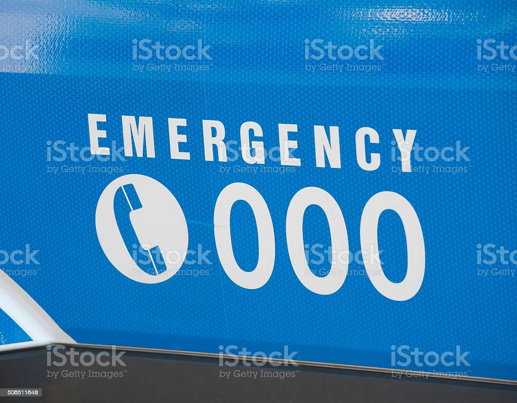 Emergency number 000 on an ambulance stock photo