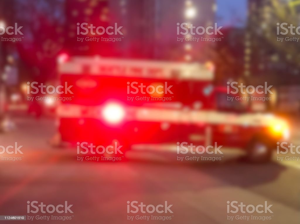 Blurred ambulance on a city street.