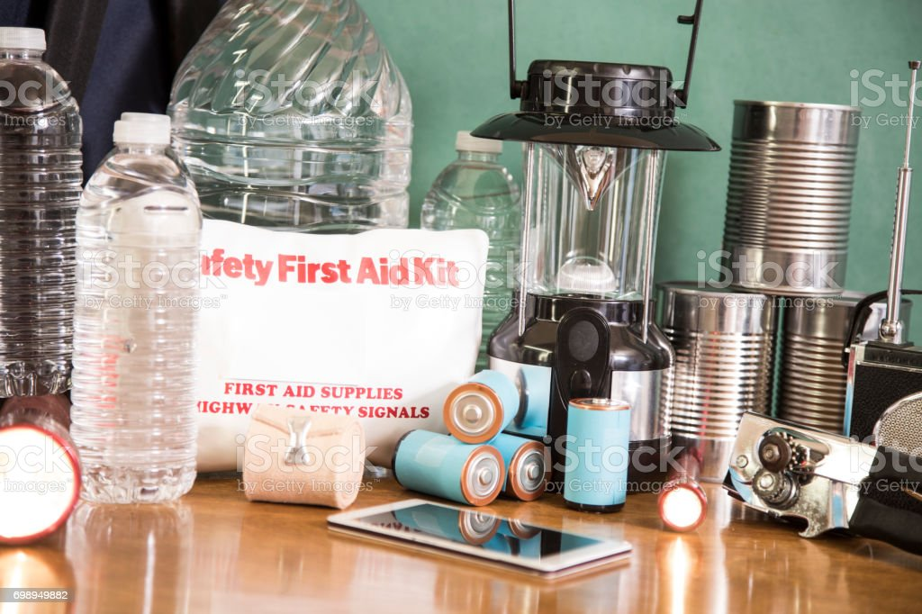 A pile of emergency preparation, natural disaster supplies including:...