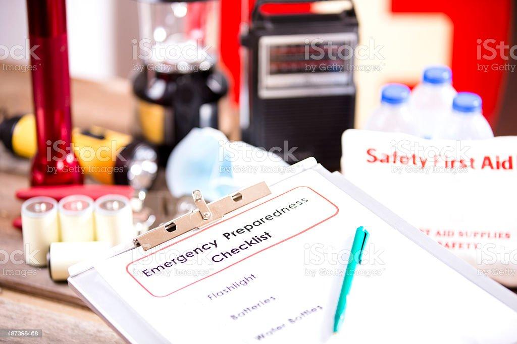 Emergency preparedness checklist and disaster supplies. stock photo