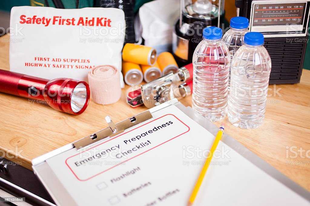 Emergency preparedness checklist and natural disaster supplies. stock photo