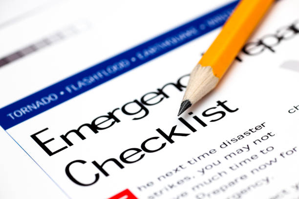 emergency preparedness checklist with yellow pencil. - emergency response stock pictures, royalty-free photos & images
