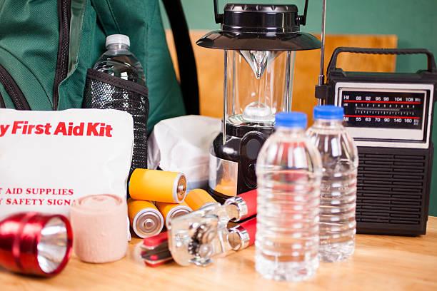 Emergency preparedness natural disaster supplies. Water, flashlight, lantern, batteries. stock photo
