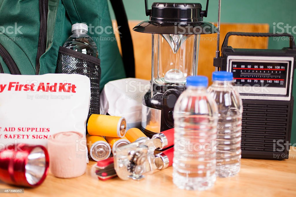 Emergency preparedness natural disaster supplies. Water, flashlight, lantern, batteries. stock photo