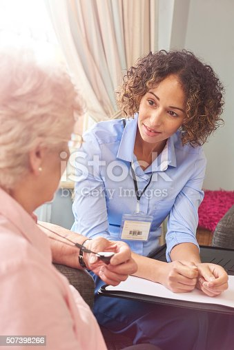 istock emergency response pendant button for senior woman 507398266