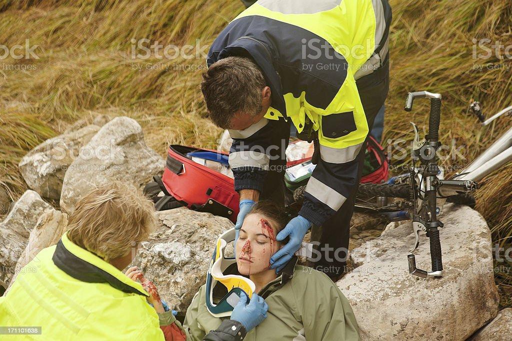 Emergency Response Team Attending Injured Woman stock photo