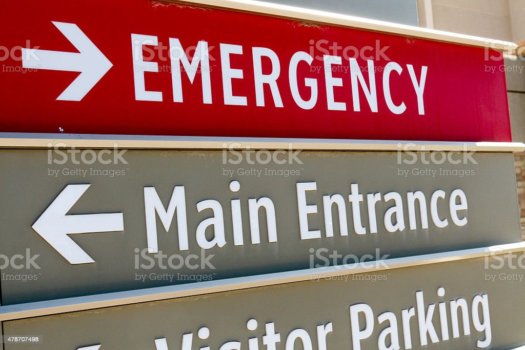 Tilted, full frame image of a gray and red sign at a hospital that...